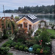 Here's a view of my greenhouse in the springtime. There's nothing like a Puget Sound water view for a backdrop! Check out the tulips growing in the cottage garden. garden photography PNW greenhouse in the spring Zen Garden Design, Garden Design Plans, Diy Garden, Garden Cottage, Spring Garden, Winter Garden, Shade Garden, Dream Garden, Home And Garden