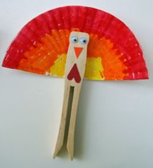 Clothespin and muffin paper turkey. I have just been inspired for a funny contest for my students to see who can come up with the most creative creature/character for the clothespin and muffin paper. Peacock? Turkey? Afro-man? Person carrying am umbrella? Love it!