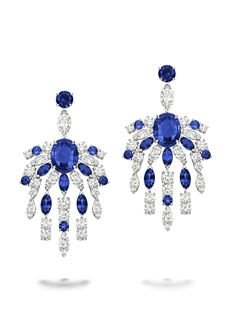 Earrings in 18K white gold set with 2 oval-cut blue sapphires , 16 marquise-cut diamonds  10 marquise-cut blue sapphires  32 brilliant-cut diamonds  and 12 round blue sapphires. #ExtremelyPiaget