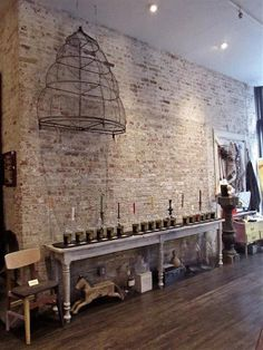 Min Apothecary and Atelier in New York, exposed brick walls, wood flooring