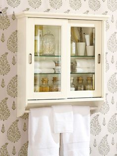 This roomy wall cabinet from Pottery Barn for $249.00 will give you extra storage plus a built-in towel bar.