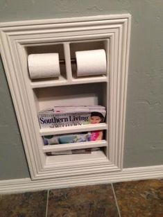 Built in bathroom toilet paper holder - but closed storage on bottom for extra toilet paper instead!