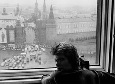 David Bowie watching May Day parade on Red Square from the window of Inturist Hotel in Moscow, 1973.