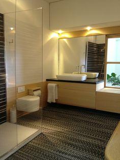 Masculine bath. I love the horizontal bamboo cabinet and wainscot.