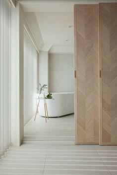 Hiroyuki Ogawa Architects divides up tiny apartment with sliding screens CHEVRON TIMBER DOOR