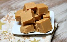 Peanut Butter Fudge  ACTIVE TIME 10 min.  INGREDIENTS  2 cups granulated white sugar ½ cup milk 1 cup peanut butter (smooth or chunky) 1 tsp vanilla extract  DIRECTIONS  Grease an 8x8-inch baking pan.  In a medium saucepan, bring sugar and milk to a boil. Allow to boil for about 2½ minutes, stirring regularly, and then remove from heat. Add the peanut butter and vanilla and stir until smooth.  Pour the mixture into the pan and allow to cool until set. Slice into 1-inch squares.