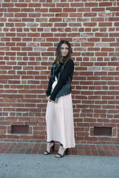 long skirt paired with a scarf and leather jacket for winter weather