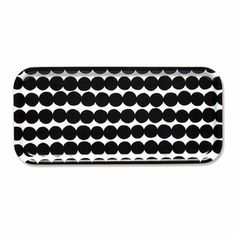 Marimekko Serving Trays The Marimekko serving trays are created from popular Marimekko textile designs. Each tray is made of original fabric that has been pressed into plywood, forming a shatter-proof, attractive tray, perfec.