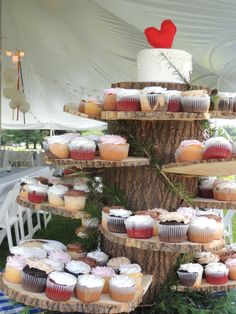 rustic cupcake display#simplydeignedspaces;photo by Maria Skinner;cupcakes by #Kenwoodcakes.com