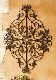 With dramatic and intricate details, the Lucca Outdoor Metal Art makes your outdoor space feel like Italy.