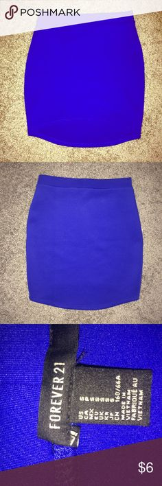 Blue body-con mini skirt Bright blue mini skirt. Very form fitting, longer in back than in front. Size small. Forever 21 Skirts Mini