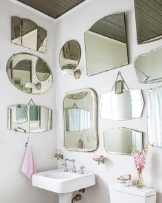 The five members of the Pata family successfully share a single bathroom—a Jack and Jill that sits between the children's rooms. A collection of vintage mirrors makes the bathroom appear larger.