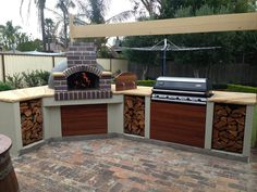 I like the right hand orientation of the built in gas grill; I also like the wood storage idea on this concept.