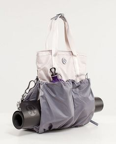 Lulumon tote - this might be the most useful bag ever, if it werent so damn sporty looking. Its just not as nice looking as some bags I own. The thing is, its so waterproof that you can spill a bottle of beer into one pocket and not have it leak into other ones. This makes it ideal for wet Bikram clothes and for use as a diaper bag. It also has a spot for my laptop. my-personal-style