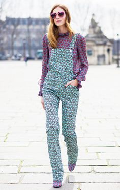 Chiara Ferragni of The Blonde Salad in a printed top, printed overalls, and Miu Miu sunglasses