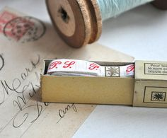 a box of vintage french laundry labels
