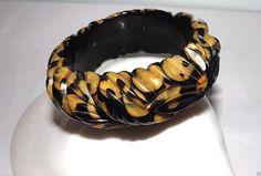 """Exceptional chunky cast carved floral design Bakelite bangle bracelet - measures 1"""" wide with 2-1/2"""" inside diameter - dealer is asking $950 obo on eBay."""