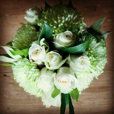 beautiful bridal bouquet with stunning white roses and chryssies