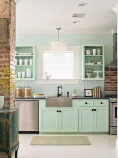 mint cabinets in kitchen, brick walls, capiz light fixture