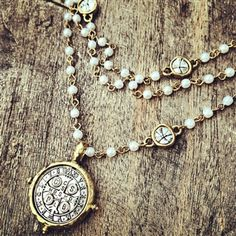 Triple Strand Pearl Medallion Necklace
