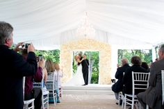 Simple Elegance: Real Weddings: Jennifer + David courtesy of #PaulVersluisPhotography #StudioDanMeiners @danmeiners  #ceremonydecor #floralwall #simpleelegance @iplanyourwed #kansascity #weddingplanner www.iplanyourwedding.com