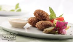 Falafel with Tarator Sauce! A traditional lebanese item that is served for lunch or dinner as a sandwich or as a vegetarian meal. It can even be placed as a mezze dish at your festive gatherings. Want to try them at home check Al Wadi Al Akhdar recipe.