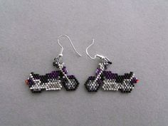 These unique earrings are just the right thing for anyone who loves Motorcycles, or owns one. The purple color is so dark that it is