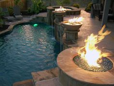 Love these firepits... Wish we could do a terraced pool & patio like this!