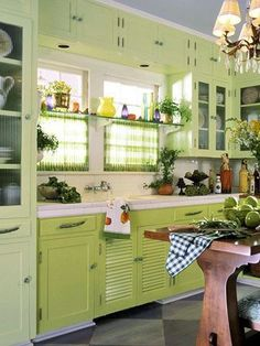Fresh, two-colored cabinets idea. Also the row of cabs above the window is nice use of space that could work at my house.