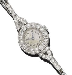 A diamond cocktail wristwatch, circa 1925 The circular dial with Arabic hour markers, within a cushion-shaped diamond bezel, between brilliant and single-cut diamond lugs, to an expandable articulated bracelet, diamonds approx. 2.30cts total, length 15.7cm