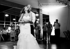 dad and daughter dancing it up at the reception.. a tender, loving happy moment