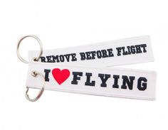 I LOVE FLYING-REMOVE BEFORE FLIGHT Keychains are 100% embroidered, with merrowed borders.