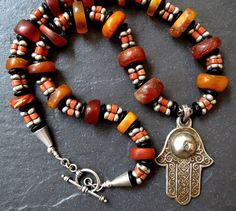 Hey, I found this really awesome Etsy listing at https://www.etsy.com/listing/198809269/moroccan-amber-and-yemeni-coral-necklace