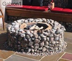 gabion firepit,  inside of gabions lined with fire bricks http://www.gabion1.co.uk