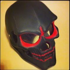 Black and red skull helmet