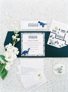 Beautiful manor and dinosaur inspired wedding stationary and details | image by Ben Yew Photography