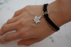 New to ThailandVintage on the Ethical Textile Etsy store: Handmade Charm Bracelet Charm Handmade Black Bracelet Gift for Girls Gift for Ladies Charm Bracelet  Gift for Her Charm Bracelets (15.00 GBP) --- Turnaround time: Our pieces are handmade and made to order for you. We currently need about 1 - 3 days for production then we ship. Shipping is secure registered and reliable and takes about 2 - 3 weeks. If you need your order sooner please send us a message and we'll be happy to help. Thank…