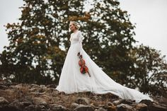 Styled Bridal Shoot in Finland. Jere Satamo Photography. Dress made by Pukuni (www.pukuni.fi). Lace back wedding dress, long lace sleeves, bridal gown, long tulle train.