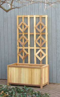 Cedar trellis and planter box combo. Functional design.