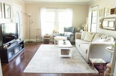 ECLECTIC LIVING ROOM REVEAL - See how a few vintage finds, subtle statement pieces, and a new beautiful rug transformed this cottage living room! www.tableandhearth.com