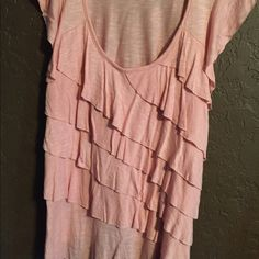 Pink ruffle top Pink ruffle in front top. Never been worn Tops Blouses