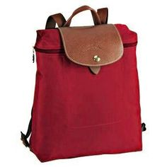 oh a backpack would be nice too.. Longchamp Le Pliage Backpack- Red