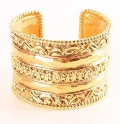Nicely designed gold cuff.
