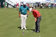 The TaylorMade Golf rep known as 'Charlie Tour' snapped this shot of TaylorMade's Shawn Mullins working with Chez Reavie and his new Ghost Spider S putter on the practice green at Kiawah.