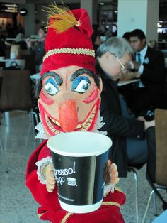 Mr Punch enjoying a coffee at Melbourne Airport.