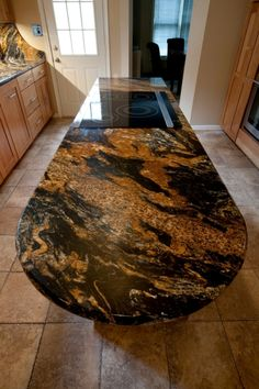 Magma Granite Countertop | By designing their house in such a sustainability-minded way, they cut ... Kitchen Redo, Rustic Kitchen, Kitchen Remodel, Kitchen Design, Granite Kitchen Counters, Marble Countertops, Log Home Kitchens, Luxury Kitchens, Maple Cabinets