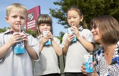 Fonterra - Howick Primary Principal Leyette Callister gives three of her students a sneak preview of the Fonterra Milk for Schools milk. Schools, Students, Milk, Business, School, Store, Business Illustration, Colleges