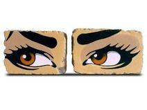 Augenpaar braun auf Backstein als Buchstützen