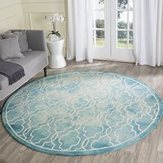 Safavieh Dip Dye Collection DDY539D Handmade Turquoise and Ivory Wool Round Area Rug, 7 feet in Diameter (7′ Diameter) #handmade The Safavieh Dip Dye Collection is the perfect blend of class and elegance. These rugs bring traditional sophistication to your home, with their Moroccan styled design. These rugs feature 100% Premium Wool, hand tufted into elegant designs, perfect for your traditional décor. Each rug has a dense, soft pile, and excellent quality, to ensure that you will en..