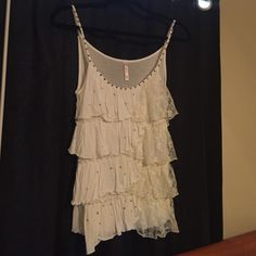 Cream ruffle lace top with added swarovski stones Gently used, added swarovski crystal rhinestones for a dance solo. Ruffles top to bottom, lace on left side. Can be dressed up with a cute jacket or casual. Rue 21 Tops Blouses
